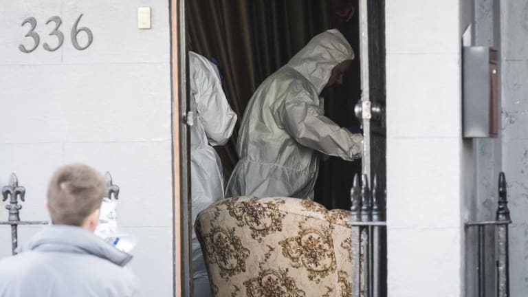Forensic officers scour a Surry Hills property where a man in his 50s was arrested.