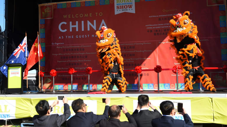 Lions perform on stage to welcome Chinese guests to the Royal Melbourne Show.
