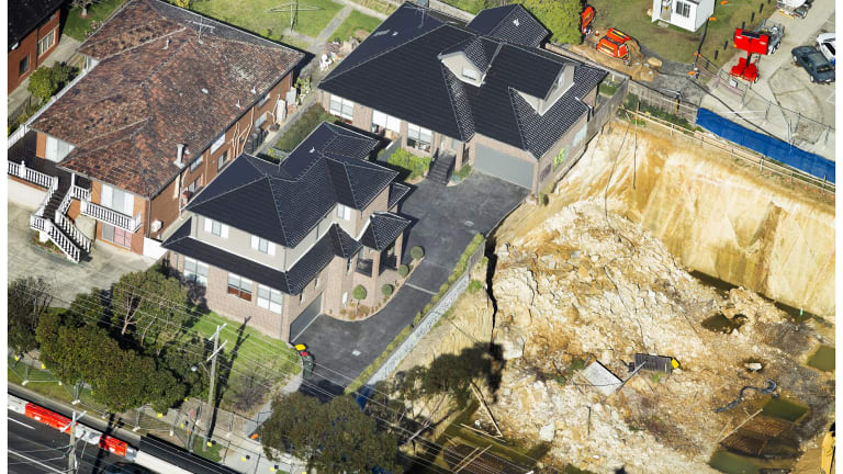 Two townhouses sit on the edge off an excavation in Mount Waverley.