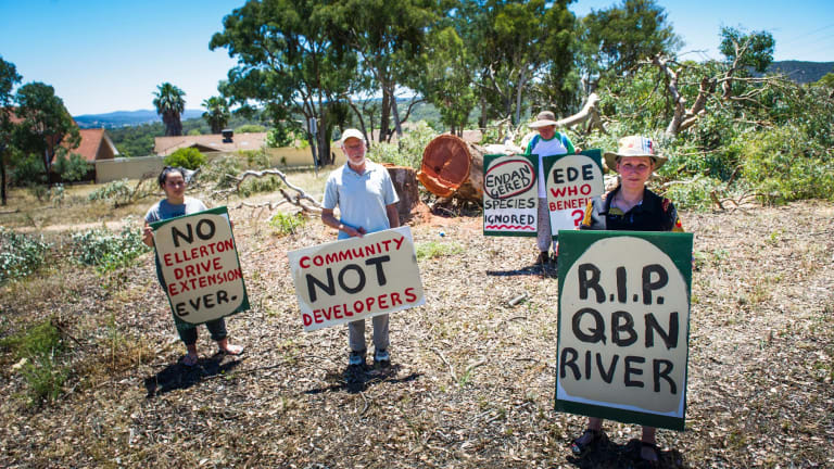 Protesters on Thursday gathered at the scene of tree-clearing for the Ellerton Drive Extension in Queanbeyan (l-r)Felicity Gare of Karabar, Frank Briggs of Queanbeyan East, Annette Schneider of Burra and Asha Gare of Karabar.