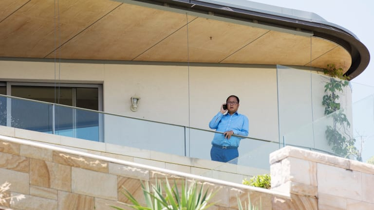 Political donor Huang Xiangmo pictured on the balcony of his house in Mosman.