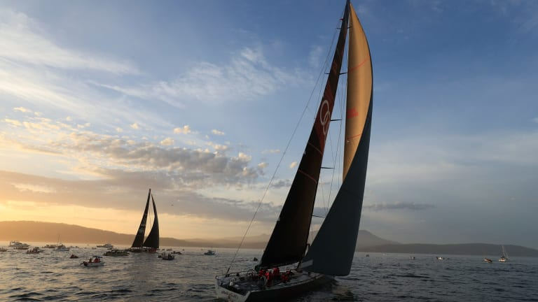 Runner-up Comanche, left, and Sydney to Hobart winner Wild Oats, right, on the River Derwent at the finish on Wednesday night.