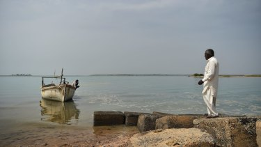 A fisherman in Gujarat's Kutch coastal region. Adani operations nearby have destroyed nets and disturbed fishing grounds.