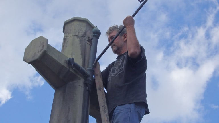 Photos of the Catholic Worker movement members removing the sword from the Cross of Sacrifice on Ash Wednesday. The group pleads not guilty to wilful damage.