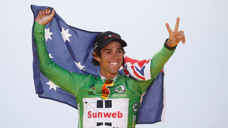 Australia's Michael Matthews celebrates after claiming the green jersey.