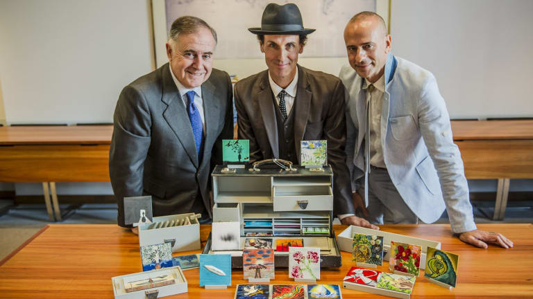 Spanish Ambassador Enrique Viguera, Melbourne artist Peter Burke and Cesar Espada with the Low Cost Diplomatic Bag at the Embassy of Spain.
