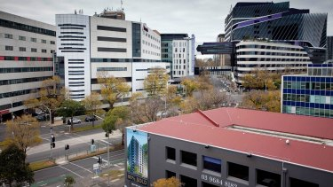 Melbourne City Council has approved a 15-level apartment tower where the building with the red roof now sits. Royal Melbourne Hospital is in the background.