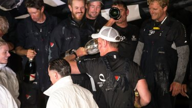 Perpetual LOYAL owner/skipper Anthony Bell celebrates with sponsors and crew at Constitution Dock after winning the 2016 Sydney To Hobart.