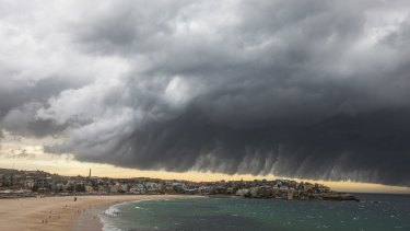 Swimmers left the water at Bondi Beach on Tuesday as the storm approached.