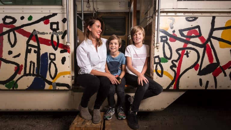 Fiona Larwill and her sons Henry, 9, and James, 13, with the tram painted by David Larwill in 1986.