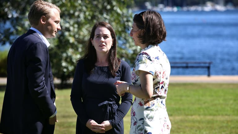 Premier Gladys Berejiklian congratulates North Shore and Manly candidates Felicity Wilson (centre) and James Griffin.
