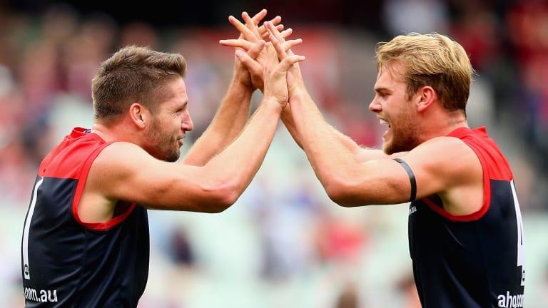 Jesse Hogan and Jack Watts of the Demons celebrate a goal.