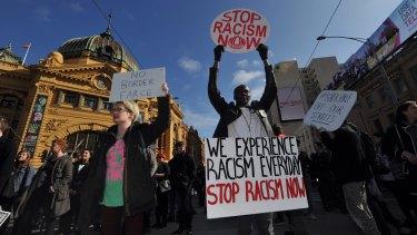 Demonstrators stop traffic outside Flinders Street Station, protesting against Operation Fortitude on August 28.