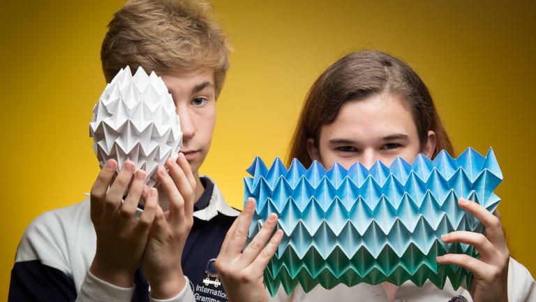 Maxim and Zelda Winestock with some of the students' art pieces at the International Grammar School in Ultimo, Sydney.