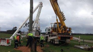 Western Power crews repairing fallen power poles.
