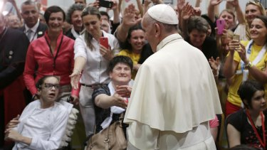 Pope Francis meets people in a youth centre dedicated to Pope John Paul II during his visit to Sarajevo, Bosnia and Herzegovina.