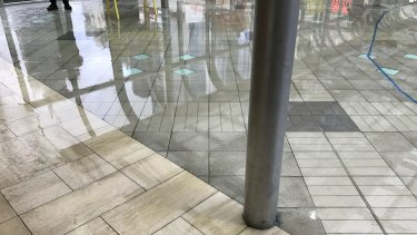 Water across the walkway that runs between Emporium and Melbourne Central in the CBD yesterday afternoon.