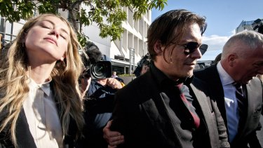 Relieved actor Johnny Depp and his actress wife Amber Heard leave Southport Court after a magistrate imposed a one month good behaviour bond on Ms Heard without conviction.
