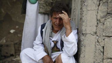 A man cries after some of his relatives were killed in a Saudi-led airstrike in Sanaa, Yemen on Monday.