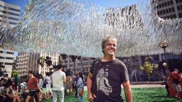 Artist Patrick Shearn with his previous aerial sculpture, Liquid Shard, in Los Angeles.