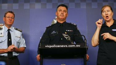 Acting Deputy Commissioner Robert Hill (centre) and Deputy Commissioner Michael Phelan.