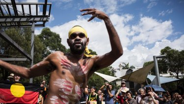 People taking part in an Invasion Day march on Australia Day.