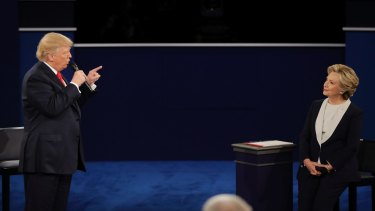 Donald Trump points towards Hillary Clinton during the second presidential debate.