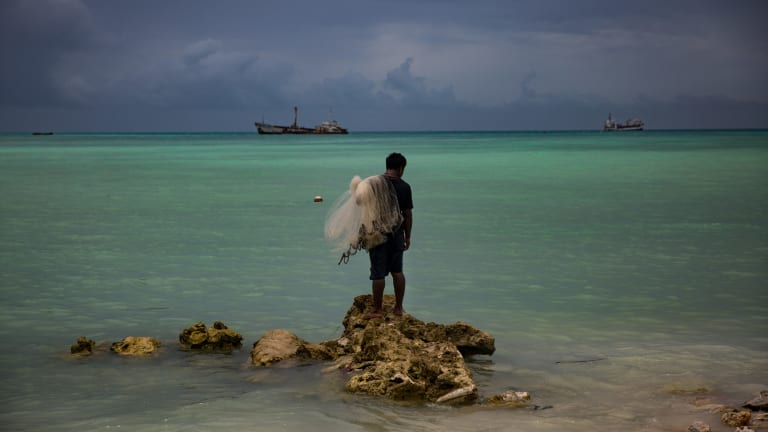 Kaitara Kautu, a net fisherman whose home flooded during a 2015 king tide in Betio, a town in Kiribati.