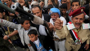 Defiant supporters of the rebel Houthi movement in Yemen's capital, Sanaa.