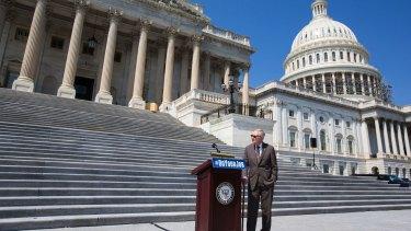 Senate Minority leader Harry Reid on the steps of the Capitol.