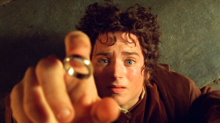 """Elijah Wood's character Frodo reaches for the """"One Ring"""", in the film <i>The Fellowship of the Ring</i>."""