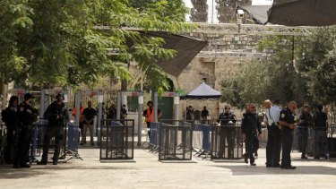 Israeli border police officers stand near security gates at the holy site.
