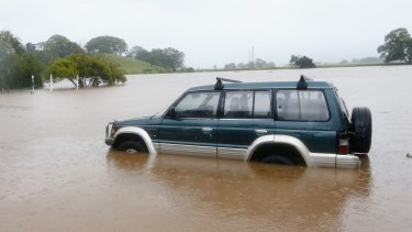 A car is trapped in the floods in Murwillumbah.