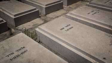 Graves of African asylum seekers in a private cemetery at Kibbutz Hatzor, southern Israel.  Most of the dead were shot and killed by Egyptian border guards.