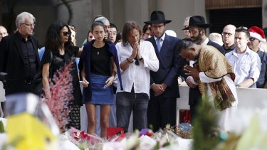 Sydney siege victim Tori Johnson's family meet with religious leaders at the Martin Place shrine to the hostages.