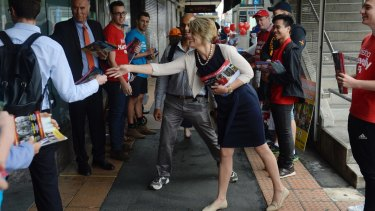 Kristina Keneally and John Alexander go head to head at the Epping pre poll booth.