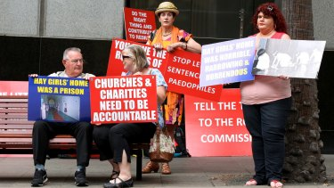 Supporters of victims who went through the Parramatta Girls Training School and the Institution for Girls in Hay protest outside the royal commission in February.