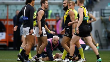 Jed Lamb on the ground after being struck by Bachar Houli.