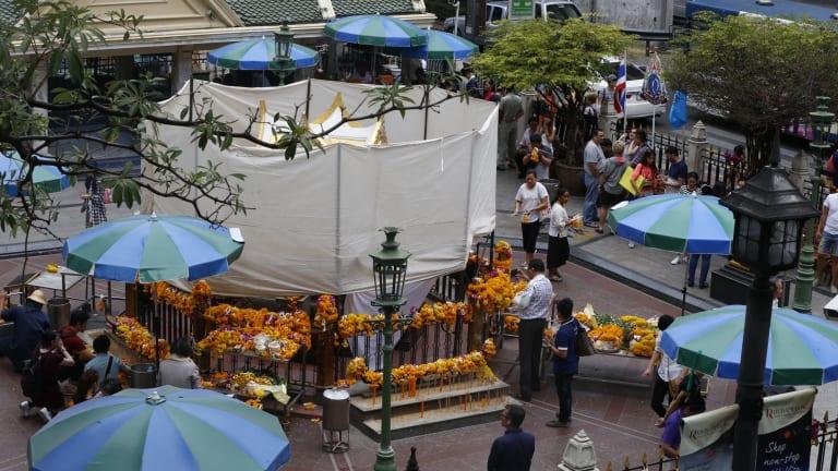 The Erawan Shrine in Bangkok is covered as repairs take place.