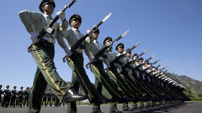 Chinese troops practice marching, ahead of a the military parade, at a camp on the outskirts of Beijing.