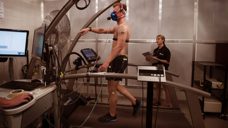 Grant Lynch (on the treadmill) with Georgia Chaseling - two PhD Students working at the  University of Sydney's special room that simulates heatwaves.