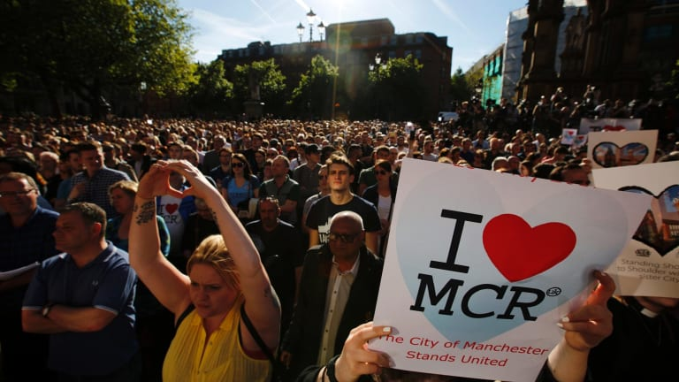 Crowds gather for a vigil in Albert Square, Manchester the day after the suicide attack at an Ariana Grande concert.