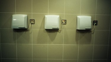 Sharing the germs: A new study has found electronic hand dryers spread more bacteria through the air than paper towels.