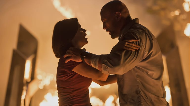Neve Campbell and Dwayne Johnson manage to keep their cool in <I>Skyscraper</I>.