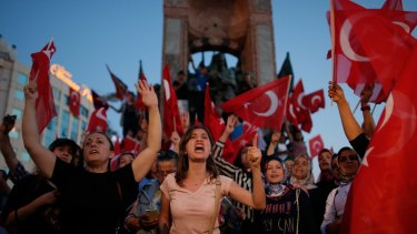 People chant slogans as they gather at a pro-government rally in central Istanbul's Taksim square.