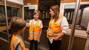 Henry, James and Fiona Larwill on the 722 tram painted by David Larwill.
