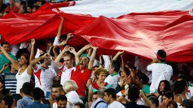 Dove is in the air: Iranian fans whoop it up at ANZ Stadium last week.