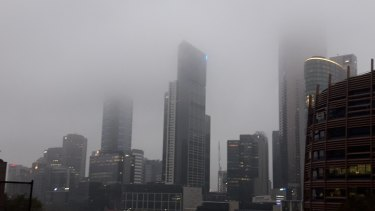 Some towers seem to have had their heads lopped off by the morning fog.