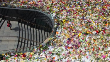 The enormous number of floral tributes in Martin Place suggest this incident has brought home to us a horrible reality.