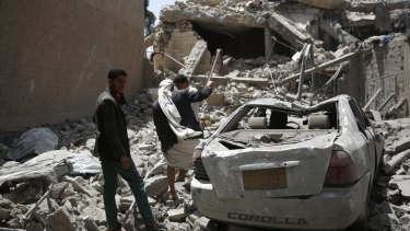 People inspect the rubble of houses destroyed in a Saudi-led airstrike in Sanaa, Yemen on Monday.